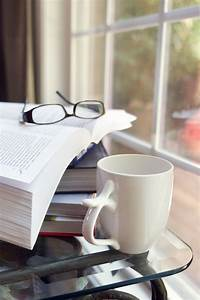 Books | Free Stock Photo | A cup of coffee with a stack of books | # 15974