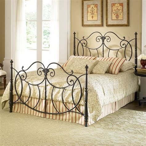 the bedroom with a decorative wrought iron bed