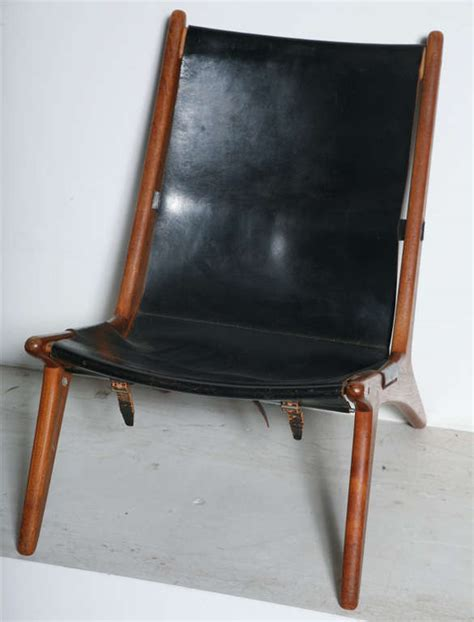 teak and leather sling back lounge chair by kristiansson