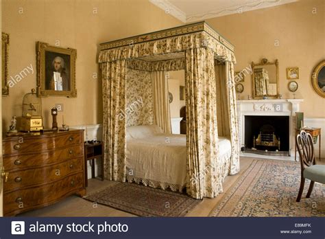 Floral Drapes And Canopy On Four Poster Bed In Country