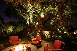 10 backyard getaways with landscape lighting With outdoor lights for oak trees