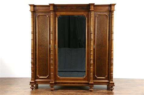 sold italian  antique walnut triple armoire