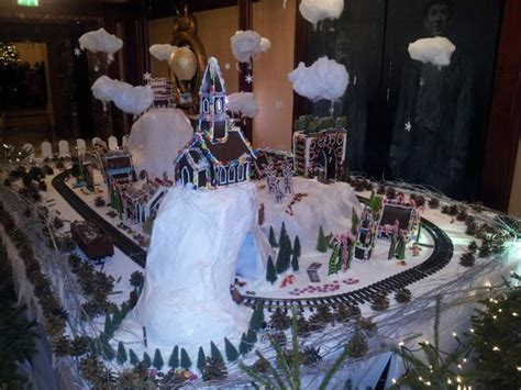 some christmas decorations with train set out side their