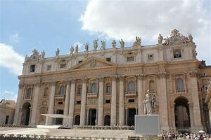 Sistine Chapel exterior, there re lots of stone statues ...