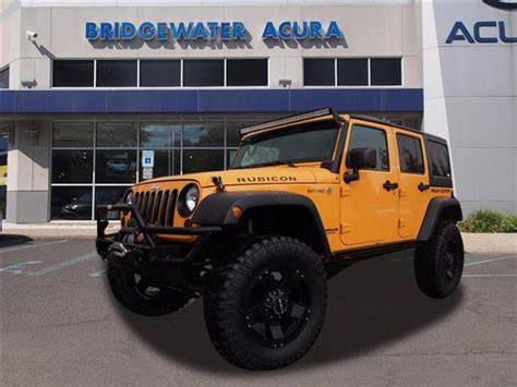 pre owned  jeep wrangler unlimited rubicon sc