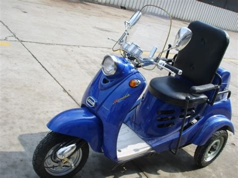 wheelchair assistance older model mobility scooter amigo