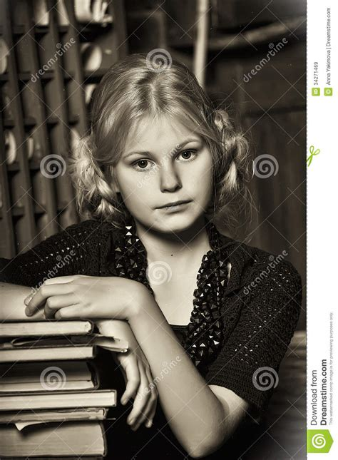 Teen Girl In Retro Style With A Stack Of Books Stock Image