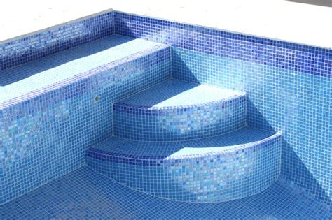 iridescent blue glass tile traditional pool miami