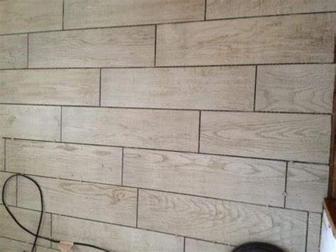 white wash wood tile montagna white wash 6 in x 24 in glazed porcelain floor and wall tile 14 53 sq ft case