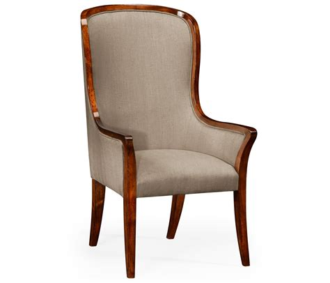 The chair is characterized by its strikingly modern lines, elegantly tapered walnut legs and generous proportions. High Back Upholstered Dining Armchair   Swanky Interiors