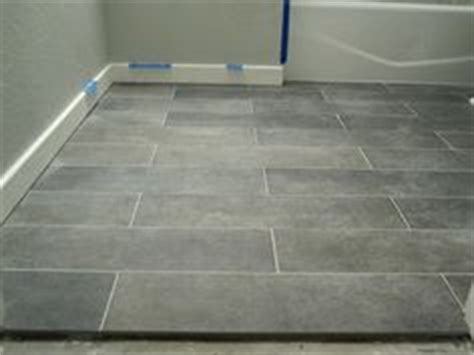 Mitte Gray Tile Grout Color by Staggered Placement Mitte Gray 12 Quot X 24 Quot Tile From Lowes