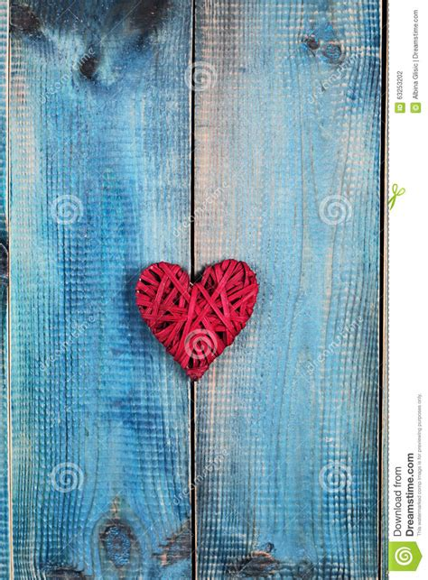 love concept red heart  blue rustic wooden background