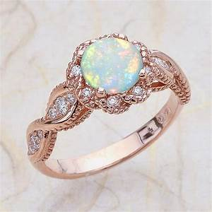 14k vintage rose gold engagement ring center is a round opal With opal wedding rings rose gold