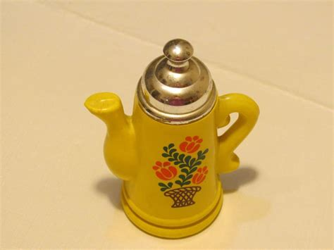 Rare Avon Bottle Perfume Teapot Mini Yellow Retro Flower Basket Floral Vintage Antique Bronze Curtain Rod Australia Cast Iron Outdoor Furniture White Stoneware Pitcher Fireplace Tools Value Desk Drawer Stops Toy Auctions Picture Frames Dublin Mens Silver Rings Uk