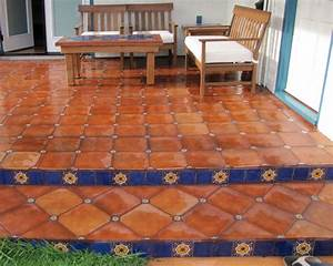 mexican floor tile combined with talavera tile inserts With kitchen colors with white cabinets with terracotta sun face wall art