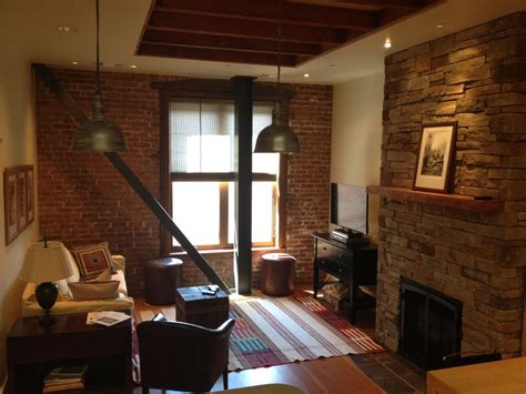 loft style apartment located   heart  downtown