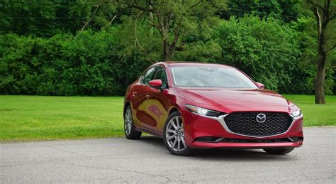 The mazda3 (known as the mazda axela in japan (first three generations), a combination of accelerate and excellent) is a compact car manufactured in japan by mazda. 2019 Mazda3 Sedan Review: Stealing BMW's Lunch in a ...