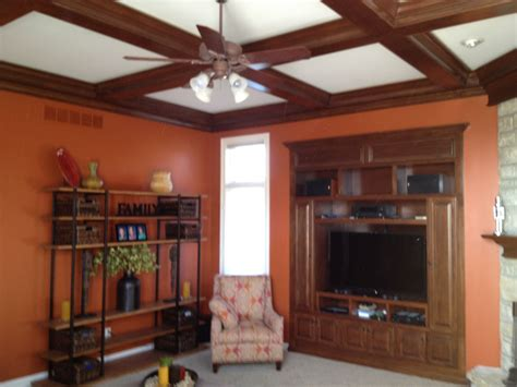 spice color walls with stained lighted coffered ceiling
