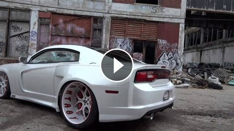white dodge charger   doors  wide body