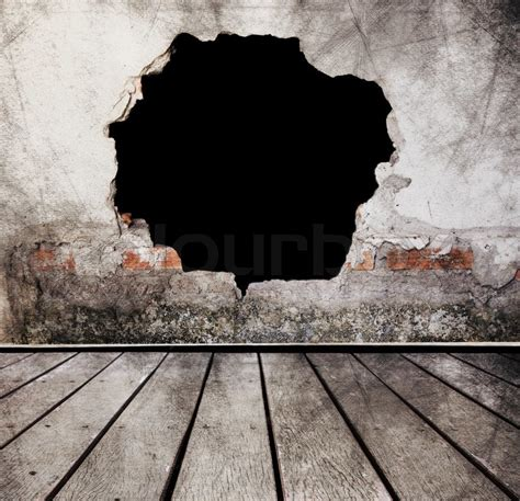 broken wall with wood floors use for scary background stock photo colourbox
