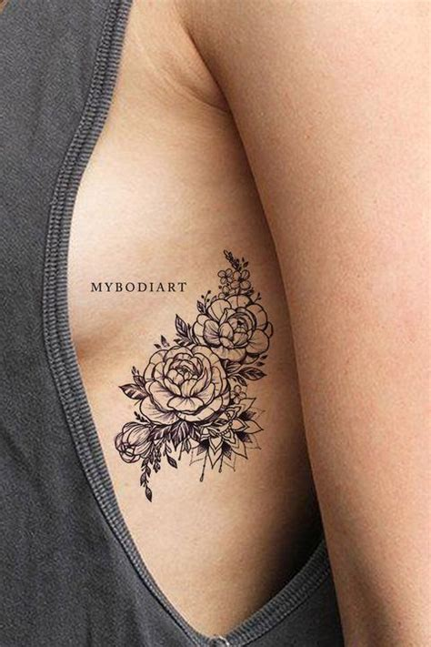 popular black mandala black floral flower rose rib tattoo