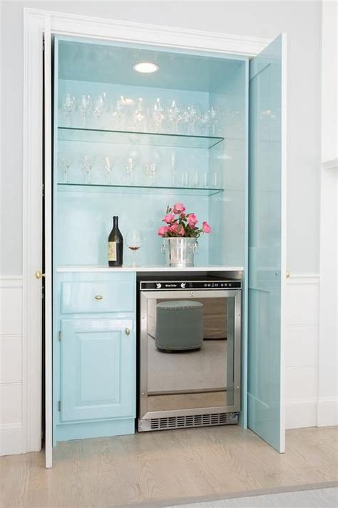 cabinet designs for kitchens turquoise blue bar with fold in doors living rooms 5053