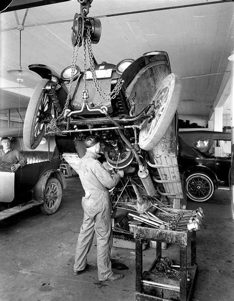 Mechanic Working On A Buick  Old Auto Repair Shops