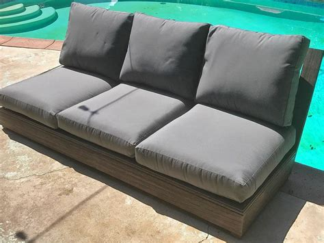 ventura teak patio armless sofa sunbrella cushion