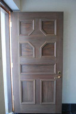 hand crafted custom walnut door  ash woodworking