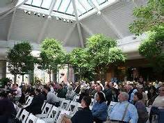 outdoor wedding inside glass indoor garden the atrium at