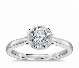 Bezel set diamond solitaire engagement ring in platinum for Wedding rings to go with solitaire engagement ring