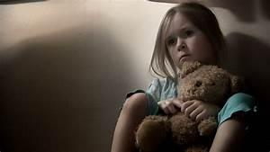 Sad Little Girl, Clutching Her Teddy Bear. Intentionally ...