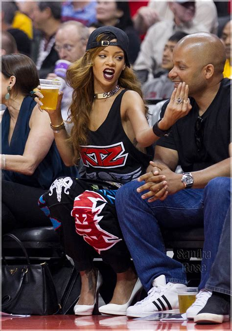 braless rihanna sits courtside   la clipper game