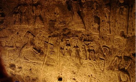 enigmatic symbols  carvings  man  cave  england