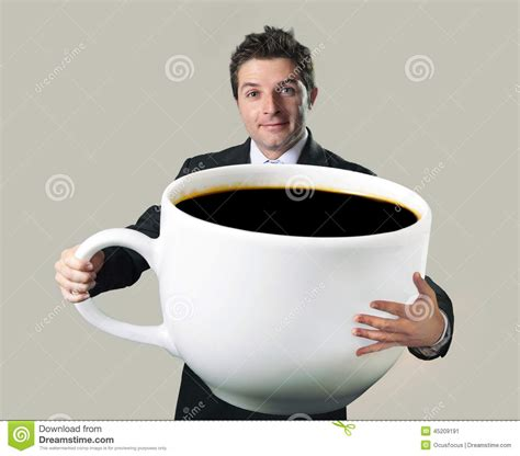 Happy Businessman Holding Funny Huge Oversized Cup Of ...