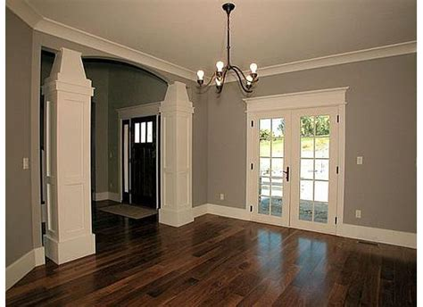 grey walls and wood floors the white trim gray walls and dark wood floors love the dark door also for the front entrance