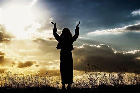 woman praying believing  photo  pixabay