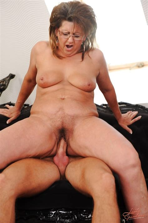 chubby granny in glasses has a hardcore sex with a younger guy at mature sex pictures