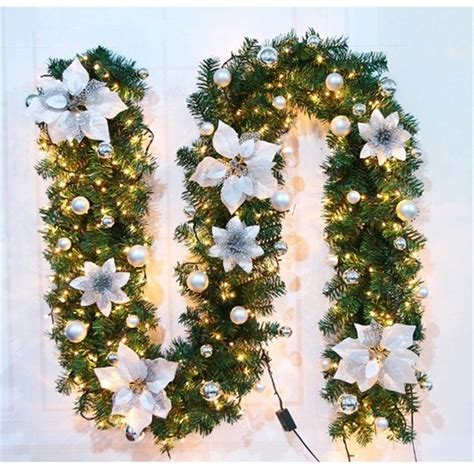 It is lit with led lights with a choice of red or white poinsettias. Christmas Decorations Garland Decoration Rattan Lights Wreath Mantel Fireplace Stairs Wall Door ...