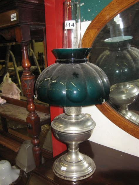 a nickel plated aladdin model ii oil lamp with green glass