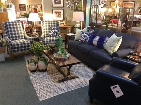 You have searched for coffee table books and this page displays the closest product matches we have for coffee table books to buy online. Navy blue sofa, plaid high-back chairs, flat weave chevron area rug, live-edge coffee table w ...