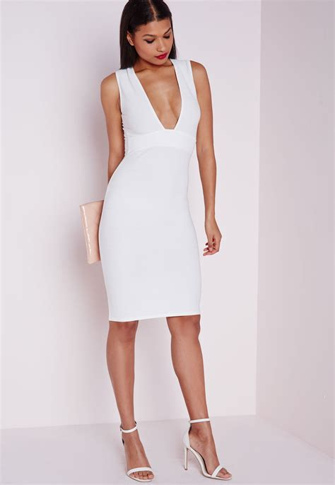 Ashley Roberts in skin-tight bandage dress for Versace ...