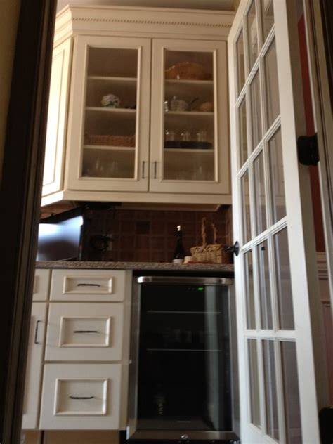 Schuler Cabinets Knotty Alder by Schuler Cabinets In White Chocolate Heirloom Black