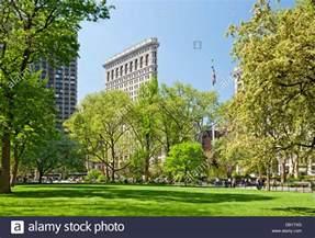 the flatiron building and square park manhattan new york stock photo royalty free
