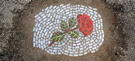 street artist replaces potholes  flower mosaics
