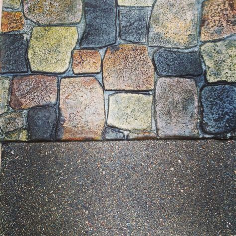 acid etched black concrete driveway with colored and