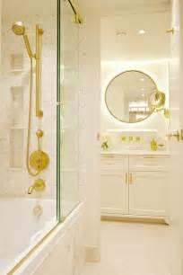 drop  bathtub  sliding glass shower doors  brass