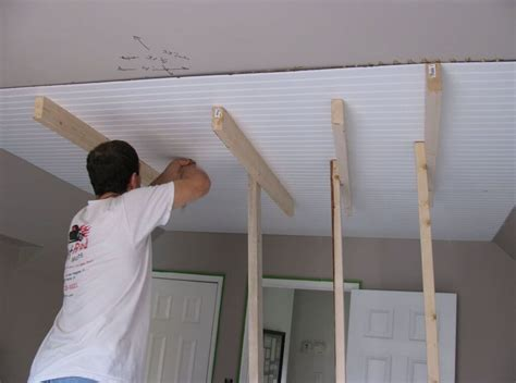 modern home interior color schemes interior worker installing beadboard ceiling panels