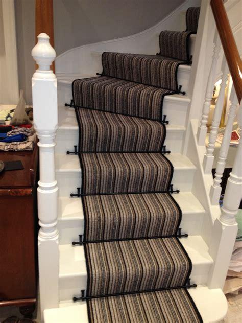 minimalist striped runners  stairs  nice dark