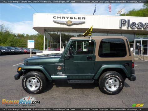 dark green jeep 2002 jeep wrangler sahara 4x4 shale green metallic camel